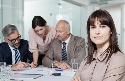 Female businesswoman in front of executive staff