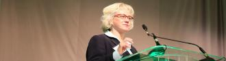 Leah Binder at podium